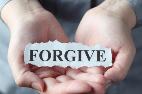 forgive paper in hand