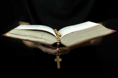 bible with rosary